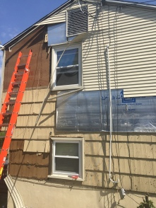Removing the vinyl siding and the wood siding underneath. It took me about a day to do this one side.
